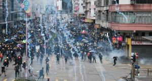 Pro-Democracy protesters throw back tear gas fired by the police during a demonstration against the controversial extradition bill in Sham Shui Po district in Hong Kong on Sunday. Photograph: Anthony Wallace/AFP/Getty Images