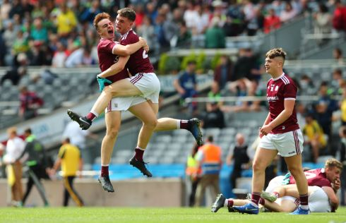UNBRIDLED JOY: Galway footballers celebrate at the final whistle on defeating Kerry in the GAA All-Ireland Minor Championship Semi-Final at Croke Park, Dublin. Photograph: James Crombie/Inpho
