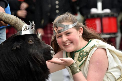 AN POC AR BUILE: Queen of Puck Fair Maeve McCarthy crowns a wild mountain goat as King Puck on Gathering Day at the annual fair, in Killorglin, Co Kerry. Photograph: Don MacMonagle