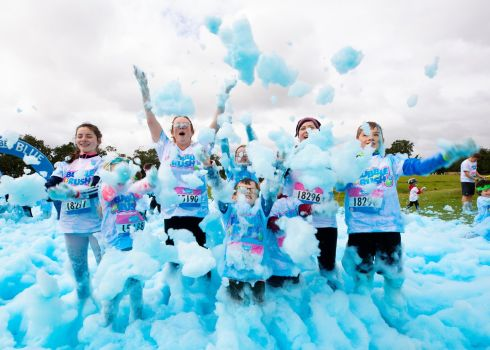 BUBBLING OVER: Members of the O'Mahony family, from Rush, Co Dublin, enjoy the Bubble Rush, in aid of children's charity Make-a-Wish, in the grounds of Malahide Castle. Photograph: Aerial.ie