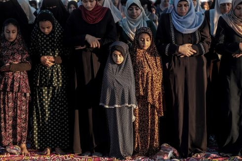 MORNING PRAYERS: Palestinian Muslim girls attend morning prayers on the first day of Eid al-Adha in Gaza City. Eid al-Adha sees Muslims slaughter a sacrificial animal and split the meat into three parts - for family,  friends and the poor. Photograph: Mohammed Saber/EPA