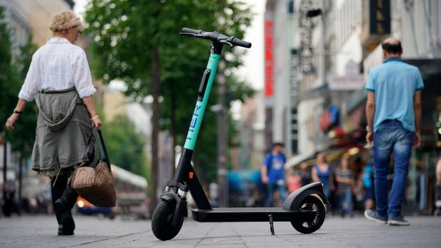 After complaints in Paris about the threat to pedestrians from e-scooters being ridden or abandoned on the pavements, city hall has introduced 20km/h (12mph) speed limits and fines of €135 (£125) for riding them on the pavement. Photograph: Ronald Wittek/EPA