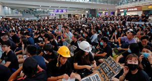 Protesters attend a mass demonstration on Monday after a woman was shot in the eye during a protest at Hong Kong International Airport. Photograph: Tyrone Siu/Reuters.