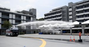 Hong Kong Police demonstrate their new water cannon equipped vehicle at the Police Tactical Unit compound in Hong Kong on Monday. Photograph: Manan Vatsyayana/AFP/Getty Images.