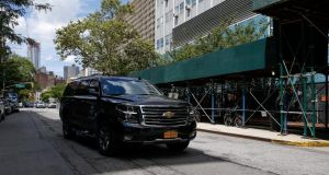 A car reportedly carrying the body of financier Jeffrey Epstein arrives at the chief medical officer's centre in New York on Saturday.  Photograph: Eduardo Munoz/Reuters