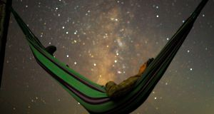 A girl lies in hammock as she looks at the Milky Way during the peak of Perseid meteor shower in Kozjak, Macedonia last August. Photograph: Ognen Teofilovski/Reuters.