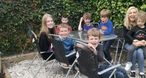 Jen Hogan with all her children at home.