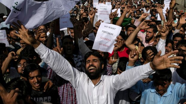 Kashmiris in Srinagar protest after prayers at a mosque: Some 300 political leaders, including two former chief ministers, have been arrested. Photograph: Danish Siddiqui