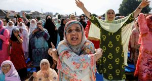Kashmiri women in Srinagar shout pro-freedom slogans before Eid prayers after the scrapping of the special constitutional status for Kashmir by the Indian government. Photograph: Danish Siddiqui