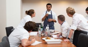 Karan Mittal, head chef at Ananda, explaining his dish to the judges at the Euro-Toques Young Chef semi-finals.