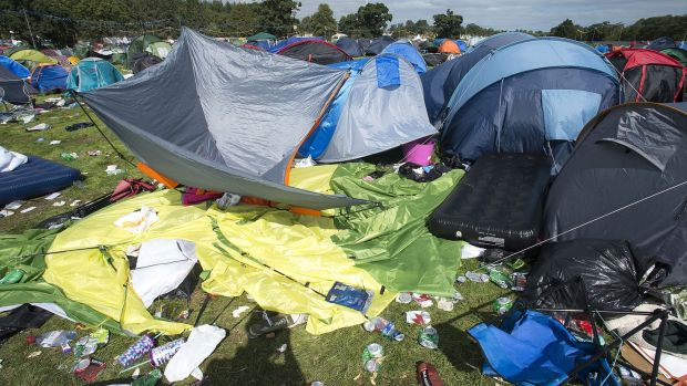 Abandoned tents and rubbish litter a campsite after last year's Electric Picnic. Photograph: Dave Meehan