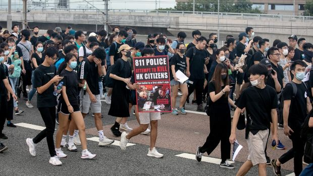 Demonstrators and travellers leave Hong Kong International Airport along a road towards Tung Chung in Hong Kong, China, on Monday, August 12th, 2019. Photographer: Kyle Lam/Bloomberg