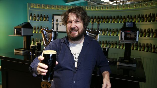 Patrick tries his hand at pouring his own pint of stout. Photograph: Nick Bradshaw/The Irish Times
