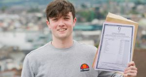 Michael O'Grady who went to Christian Brothers College in Cork with  his Leaving Cert results. Photograph: Daragh Mc Sweeney/Provision