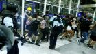 Police clash with anti-government protesters at the airport in Hong Kong, China. Photograph: Thomas Peter/Reuters