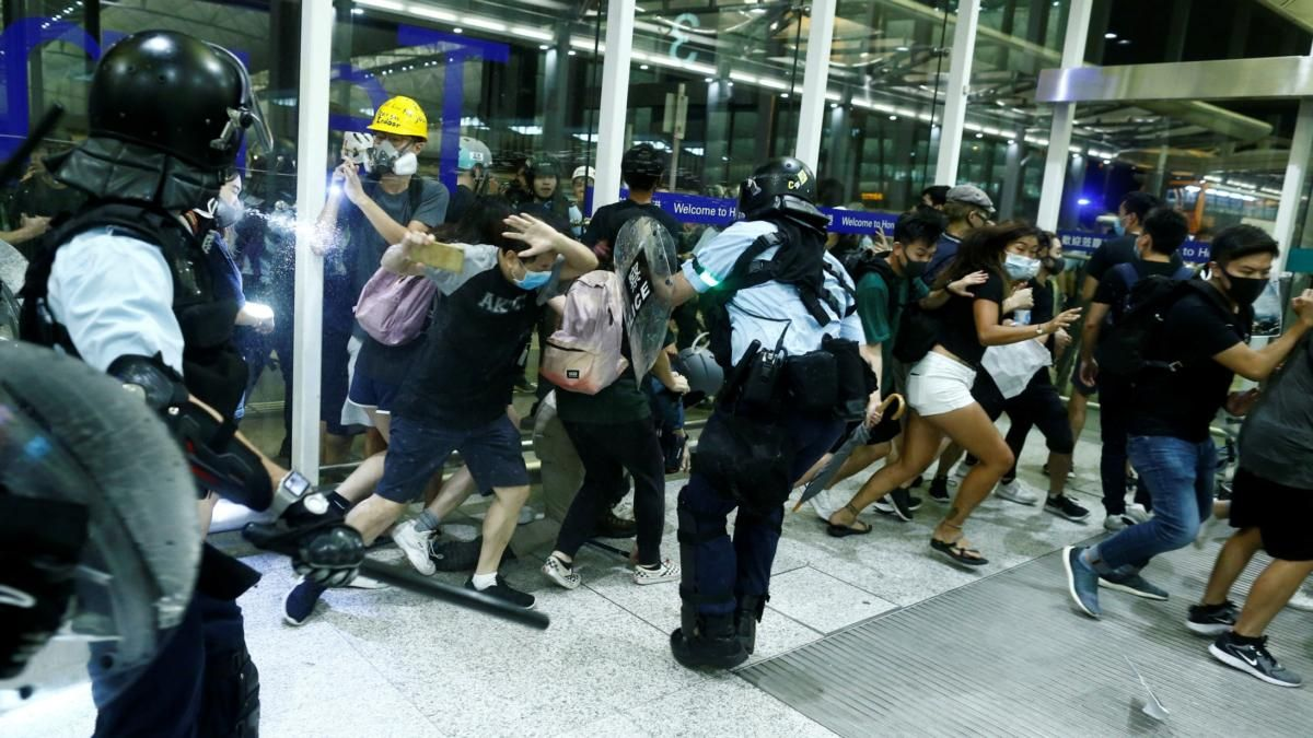 Chaotic scenes at Hong Kong airport as protesters clash with