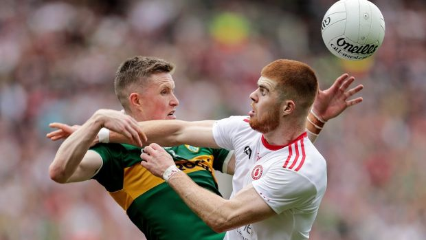 Kerry's Jason Foley battles for the ball with Cathal McShane of Tyrone. Photograph: Laszlo Geczo/Inpho