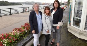 Kathleen Gillespie (left), Therese McCann (centre) and Anne Walker, who have all shared stories of their experiences of the Troubles  through performance, pictured alongside the  River Foyle in Derry. Photograph: Trevor McBride