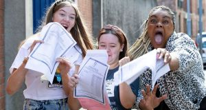 Mount Carmel Secondary School students Sarah Louise Bardon, Chloe Walsh  and Omo Ehimare celebrate after   receiving their Leaving Cert  results. Photograph: Tom Honan