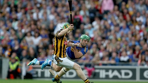 Richie Power of Kilkenny with James Barry of Tipp during the 2014 game. Photo: Donall Farmer/Inpho