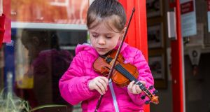 Mary McCaffery (5) from Trillick, Co Tyrone on August 12th. Mary has only been playing the violin for about six months. Photograph: James Forde