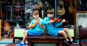 The next generation at Fleadh Cheoil na hÉireann 2019: brothers Bobby (7) and Finn (10) Hand from Dunleer, Co Louth on August 11th. Photograph: Tom Honan
