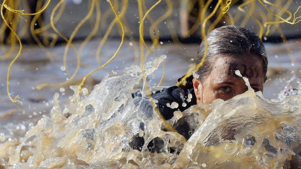 A participant competes in the Tough Mudder event at Raceway Park in Englishtown, New Jersey. The individualisation of sport is a growing trend. Photograph: Bruce Bennett/Getty Images