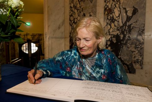 CONDOLENCES: Human rights lawyer Padraigin Drinan writes a message in the book of condolence at Belfast City Hall to the family of Nora Quoirin, whose body was discovered more than a week after she went missing in Malaysia. Photograph: Liam McBurney/PA Wire
