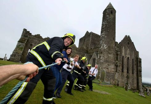 COMPETITION: Firefighters from Co Tipperary will battle it out in a test of physical fitness and endurance at the inaugural Setanta Fire Service Games next month. Pictured at the launch at the Rock of Cashel are (from left) Dearan O'Gorman (Nenagh Fire Station), Chloe Williamson (Setanta College), Paul Gallagher (Assistant Fire Chief Tipperary Fire Services), David Higgins (Cashel Fire Station), James Halpin (Cahir Fire Station) and Dave Carroll (Chief Fire Officer Tipperary Fire Services). The first of their kind in Ireland, the games will take place at Thurles Fire Station on Saturday, September 14th. Photograph: Mark Stedman
