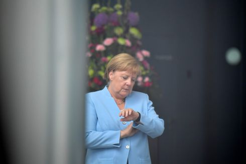 TICK TOCK: German chancellor Angela Merkel waits before welcoming Lithuania's to the Chancellery in Berlin. Photograph: Tobias Schwarz/AFP/Getty