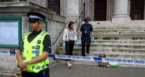 Forensic experts inspect a bag on St John's Smith Square, after a stabbing incident near the Home Office in London on Thursday. Photograph: Simon Dawson/Reuters