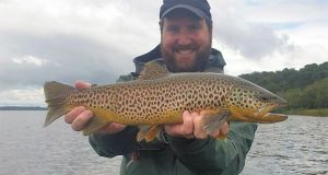 Honeymooner, Eric Klingmann from the US with a fine Corrib trout. Photograph, Tom 'Doc' Sullivan.