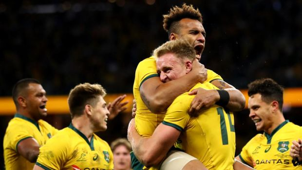 Will Genia congratulates Reece Hodge after scoring a try during the Rugby Championship match between Australia and New Zealand at Optus Stadium in Perth. Photograph: Cameron Spencer/Getty Images