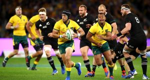Australia outhalf Christian Lealiifano, supported by Kurtley Beale,  runs the ball during the  Rugby Championship match against New Zealand at Optus Stadium  in Perth. Photograph: Cameron Spencer/Getty Images