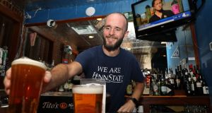 "Exile's barman Donagh Gilhooly: ""The warmth and welcome of an Irish bar, but without being too heavily themed."" Photograph: Marty Katz/washingtonphotographer.com"