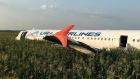 Aircraft with no landing gear and 233 passengers safely lands in corn field