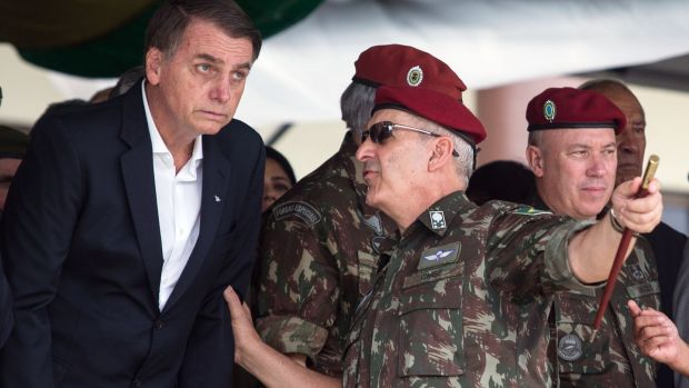 Brazilian president Jair Bolsonaro speaks to army general Luiz Eduardo Ramos Baptista Pereira: the generals have been serially humiliated by the president and his sons. Photograph: Fernando Souza/AFP/Getty