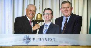 Maurice Pratt. chairman Uniphar with Daryl Byrne, chief executive of Euronext Dublin, and Ger Rabbette. chief executive, Uniphar at the bell ringing ceremony at Euronext Dublin.