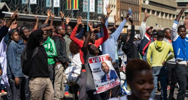 Protesters hold a poster of opposition Movement for Democratic Change leader Nelson Chamisa during an anti-government protest at Unity Square in Harare, Zimbabwe. Photograph: Zinyange Auntony/AFP/Getty Images