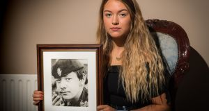 Zara Ferguson holding a photograph of her late uncle Alan, killed by the IRA in 1978. Photograph: Ronan McGrade/Pacemaker Press