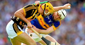 Kilkenny's Walter Walsh comes under pressure from Tipperary's Séamus Kennedy. Photograph: James Crombie/Inpho