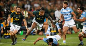 South Africa winger S'busiso Nkosi leaps with the ball before scoring a try during the Test match against  Argentina at the Loftus Versfeld Stadium in Pretoria. Photograph: Marco Longari/AFP/Getty Images