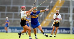 Kilkenny's Grace Walsh and Cait Devane of Tipperary battle for possession during the Liberty Insurance All-Ireland Senior Camogie Championship semi-final at the  LIT Gaelic Grounds. Photograph: Ryan Byrne/Inpho