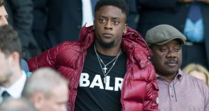 New Celtic signing  Jonathan Afolabi in the stands at Celtic Park during the Betfred Cup second-round match against Dunfermline. Photograph: Jeff Holmes/PA Wire
