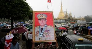 A man holds a portrait of Myanmar's military commander-in-chief  Gen Min Aung Hlaing during a rally to denounce  US sanctions in Yangon earlier this month. Photograph: Lynn Bo Bo/EPA