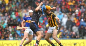 Kilkenny's Colin Fennelly collides with Tipperary goalkeeper Brian Hogan. Photograph: Ryan Byrne/Inpho