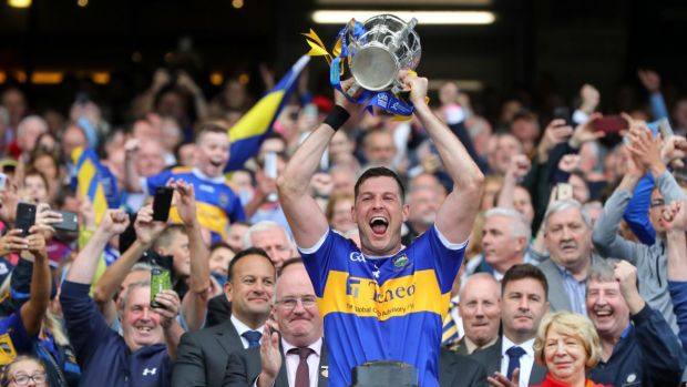 Tipperary captain Séamus Callanan lifts the Liam MacCarthy trophy at Croke park. Photograph: Ryan Byrne/Inpho