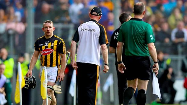 Kilkenny's Richie Hogan walks past manager Brian Cody after being sent off during the All-Ireland hurling final at Croke Park. Photograph: Tommy Dickson/Inpho