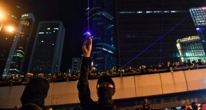 Anti-extradition Bill protesters point laser beams outside the Legislative Council in Hong Kong. Photograph: Lillian Suwanrumpha/AFP/Getty