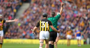 Kilkenny's Richie Hogan receives a red card from referee James Owens towards the end of the first half of the All-Ireland hurling final at Croke Park. Photograph: Ryan Byrne/Inpho